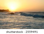 Big waves at sunset on Oahu, Hawaii - stock photo
