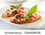 italian appetizer bruschetta... | Shutterstock . vector #256008658