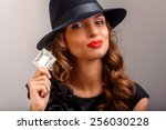 girl suggesting a condom ... | Shutterstock . vector #256030228