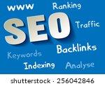 seo symbol white paper on blue...   Shutterstock .eps vector #256042846