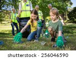 happy family collecting rubbish ... | Shutterstock . vector #256046590