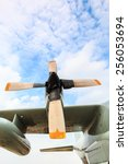 Small photo of Airscrew engine of airplane from low angle, military aircraft