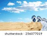towel of blue flip flops and... | Shutterstock . vector #256077019