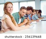 fashion students taking notes... | Shutterstock . vector #256139668