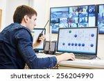 security guard watching video... | Shutterstock . vector #256204990