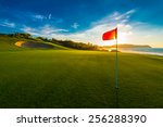 red flag at the beautiful golf... | Shutterstock . vector #256288390