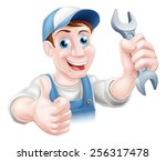 a plumber or mechanic in hat... | Shutterstock .eps vector #256317478