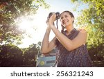 pretty hipster taking a photo... | Shutterstock . vector #256321243