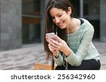 young woman sitting on a bench...   Shutterstock . vector #256342960