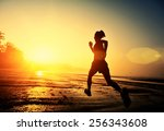 young fitness woman jogging at... | Shutterstock . vector #256343608