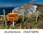 Warning Sign On The Edge Of...