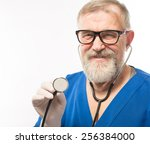 portrait of an old male doctor... | Shutterstock . vector #256384000