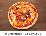 pizza with anchovies and olives ... | Shutterstock . vector #256391578