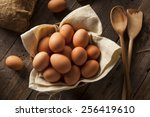 Raw Organic Brown Eggs In A...