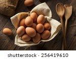 Raw Organic Brown Eggs In A...