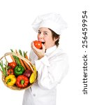 chef holding a basket of fresh...