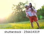 Young Couple In Love Having Fu...