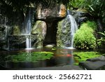 lush green tropical koi pond... | Shutterstock . vector #25662721
