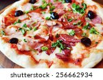 big hot pizza with olives and... | Shutterstock . vector #256662934