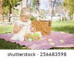 cute baby girl enjoys coloring... | Shutterstock . vector #256683598