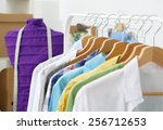 clothes hang on a shelf in ... | Shutterstock . vector #256712653