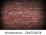 Close Up Of A Red Worn Brick...