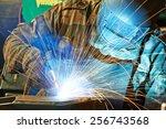 welder working with electrode... | Shutterstock . vector #256743568