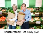 happy mature couple holding a... | Shutterstock . vector #256839460