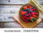 berries on wooden background | Shutterstock . vector #256855906