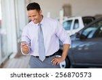 happy car salesman using smart... | Shutterstock . vector #256870573