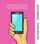 hand holding phone | Shutterstock .eps vector #256881109