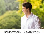 cheerful young man standing... | Shutterstock . vector #256894978