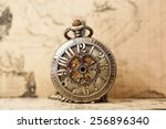 Vintage Clock On Antique Map....