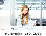 pretty secretary sitting at a... | Shutterstock . vector #256912963