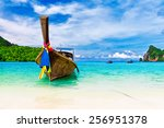 long boat and tropical beach ... | Shutterstock . vector #256951378