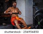 man running rowing excercise in ...   Shutterstock . vector #256956850