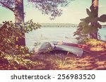 canoes pulled up on the shore ... | Shutterstock . vector #256983520