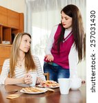 Small photo of Two women having squabble at table