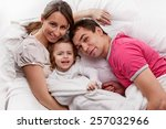 above view of a family lying on ... | Shutterstock . vector #257032966