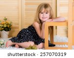 cheerful girl plays with her... | Shutterstock . vector #257070319