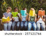 children sitting in row and... | Shutterstock . vector #257121766