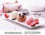 Stock photo three scoops of ice cream chocolate vanilla strawberry 257125294