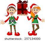 two christmas elf holding a gift