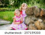 happy little girlfriends in park | Shutterstock . vector #257159203