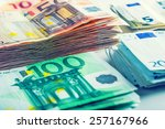 Several hundred euro  banknotes stacked by value. - stock photo