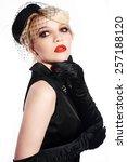 portrait blonde in black hat