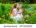mother with her baby in the... | Shutterstock . vector #257202829