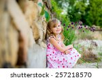 happy baby in spring park... | Shutterstock . vector #257218570