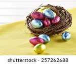 Chocolate Eggs In Nest On White