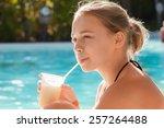 little blond girl drinks... | Shutterstock . vector #257264488